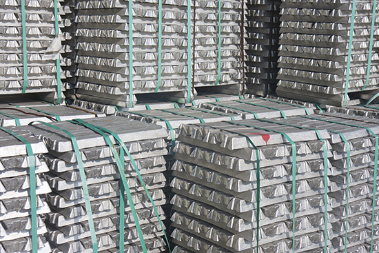 Aluminum ingots, possibly waiting at a Metro International warehouse for load out.