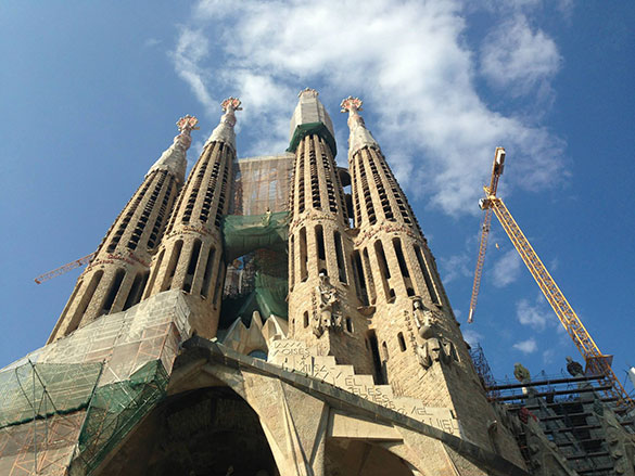 low angle sagrada familia bluesky clouds
