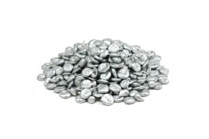 a handful of granular zinc on a white background
